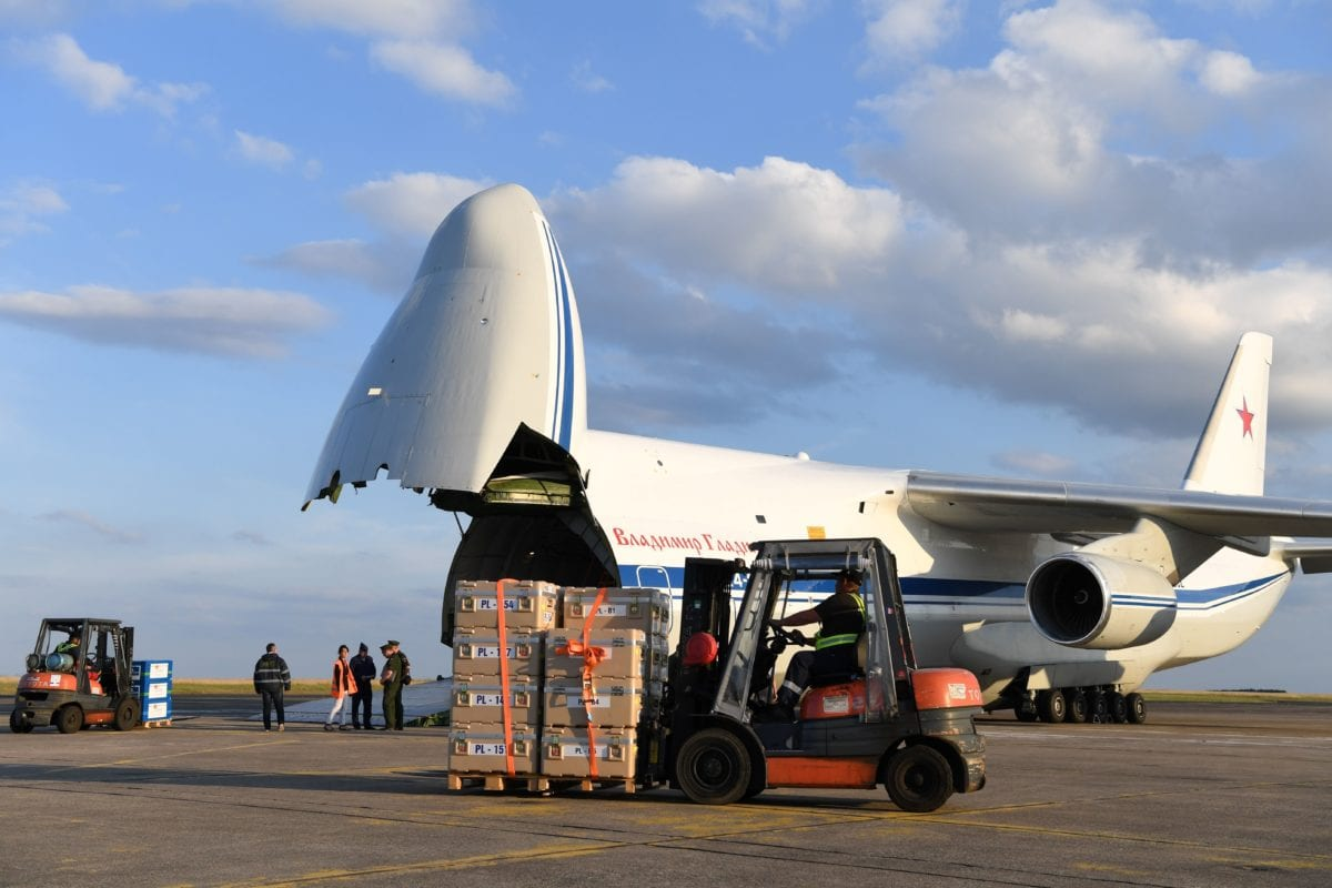 Crates containing humanitarian aid are loaded onto an Antonov An-124 Ruslan - Widebody at the former Chateauroux-Deols Marcel Dassault Airport in central France on July 20, 2018. - France and Russia are jointly delivering humanitarian aid to the former Syrian rebel enclave of Eastern Ghouta, the French Presidency said in a statement with Russia on July 20. [Photo by Alain JOCARD / AFP/Getty Images]