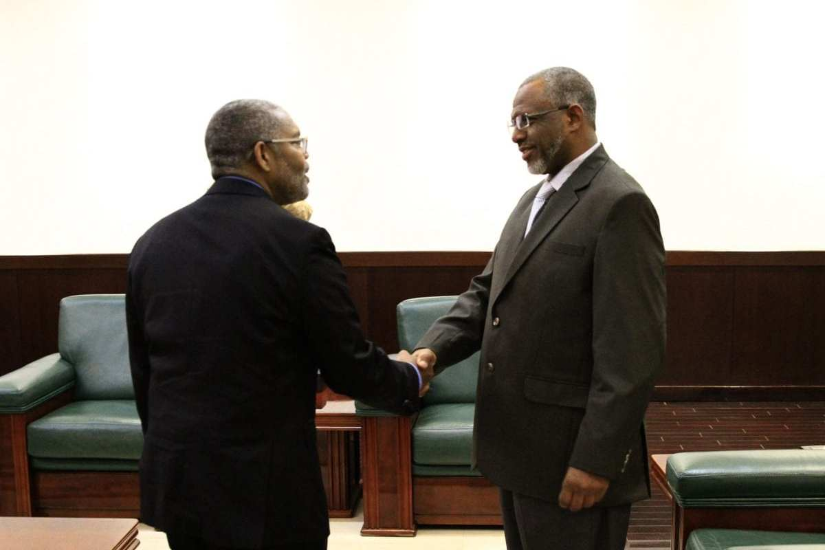 Cyril Sartor (L), special assistant to the US president and senior director for African Affairs at the National Security Council, meets with Sudanese Prime Minister Moutaz Mousa Abdallah in the capital Khartoum on 20 February 2019. [EBRAHIM HAMID/AFP/Getty Images]