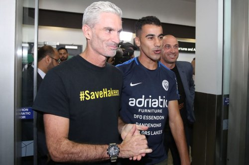 Refugee Bahraini footballer Hakeem al-Araibi walks with Craig Foster, former Australian football captain and commentator as he arrives at Melbourne Airport on 12 February 2019 in Melbourne, Australia. [Scott Barbour/Getty Images]