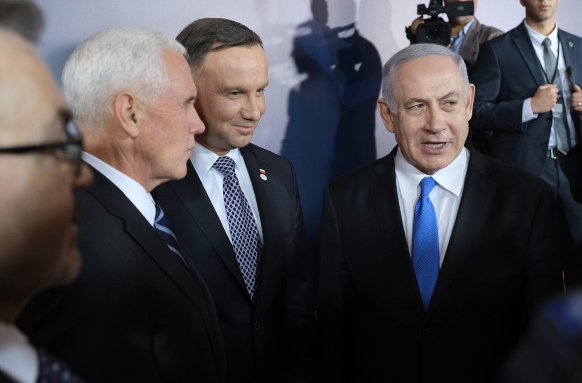 "U.S. Vice President Mike Pence (L), Polish President Andrzej Duda (C) and Israeli Prime Minister Benjamin Netanyahu chat following a group photo prior to the dinner on the opening evening of the ""Ministerial to Promote a Future of Peace and Security in the Middle East"" on 13 February 2019 in Warsaw, Poland [Sean Gallup/Getty Images]"