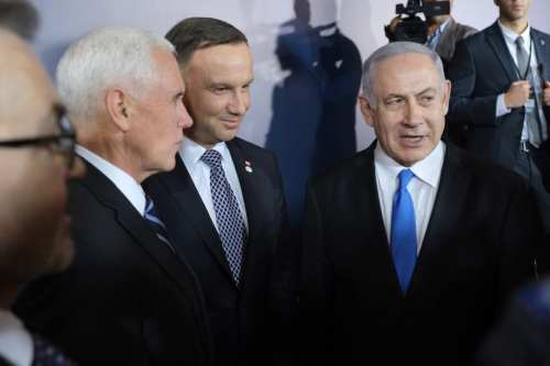 """U.S. Vice President Mike Pence (L), Polish President Andrzej Duda (C) and Israeli Prime Minister Benjamin Netanyahu chat following a group photo prior to the dinner on the opening evening of the """"Ministerial to Promote a Future of Peace and Security in the Middle East"""" on 13 February 2019 in Warsaw, Poland [Sean Gallup/Getty Images]"""