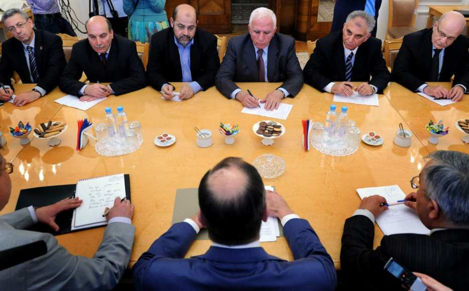Russian Foreign Minister Sergei Lavrov (foreground-C) meets with Fatah member Azzam al-Ahmed (Backround 3-R) Mussa Abu Marzuk of Hamas (Background 3-L) , and Maher al-Taher (Background 2-L) of the Popular Front for the Liberation of Palestine and other members of the Plestinian delegation during their meeting in Moscow on 23 May 2011. [ALEXANDER NEMENOV/AFP/Getty Images]