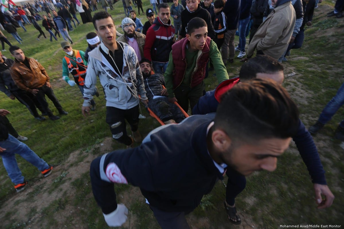 Israeli forces fire at Palestinians during the Great March of Return on 22 February 2019 [Mohammed Asad/Middle East Monitor]