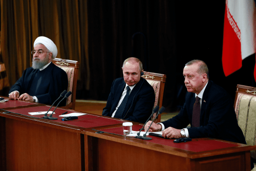 Turkish President Recep Tayyip Erdogan (R), Iranian President Hassan Rouhani (L) and Russian President Vladimir Putin (C) hold a joint press conference following the 4th trilateral summit on Syria on 14 February, 2019 in Sochi, Russia. [Turkish Presidency/Murat Cetinmuhurdar/Handout/Anadolu Agency]