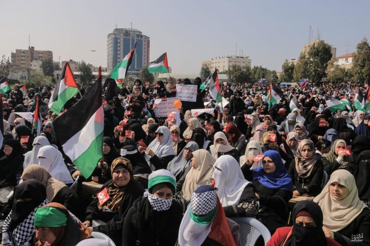 Palestinian protestors seen at a protest in Gaza's Saraya Square, calling for the resignation of Mahmoud Abbas, on February 24, 2019