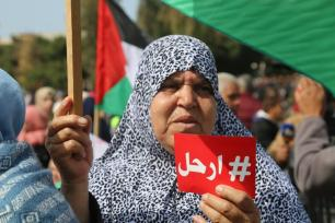 The mother of Palestinian medic, Mousa Abu Hasanein, who was fatally shot by Israeli snipers in Gaza calls for PA President Mahmoud Abbas to step down on 24 February 2019 [Wafa Aludaini/Middle East Monitor]