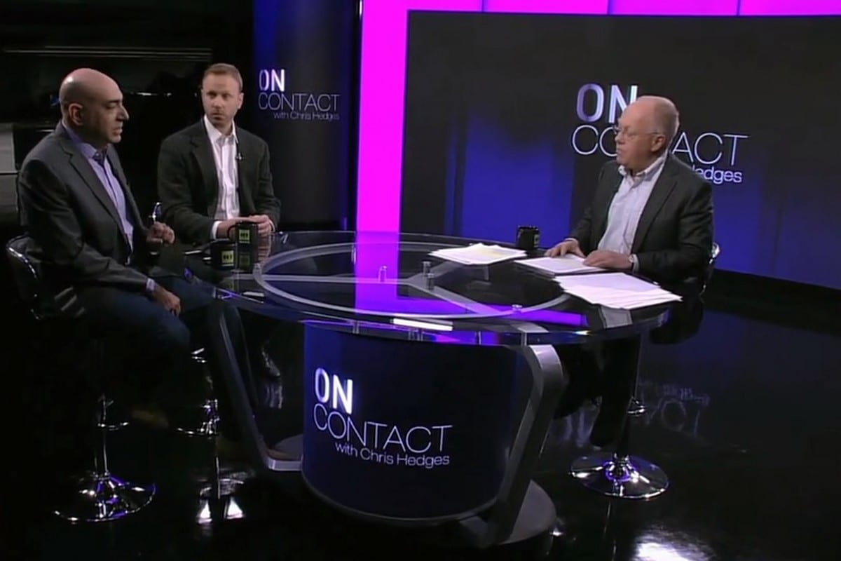 American journalist Chris Hedges (R), on his talk show 'On Contact'
