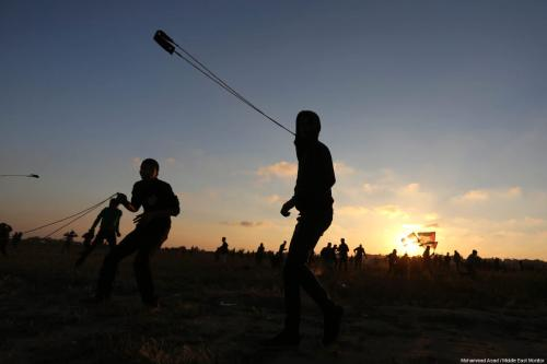 """Palestinian protestors seen during a weekly """"Great March of Return"""" demonstration near the Israel-Gaza border, on March 22, 2019 [Mohammad Asad / Middle East Monitor]"""
