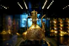 "Tombac zam-zam pitcher is displayed at Tombac: ""Elegance with a Touch of Gold"" exhibition in Istanbul on 5 March 2019 [Veli Gürgah - Anadolu Agency]"