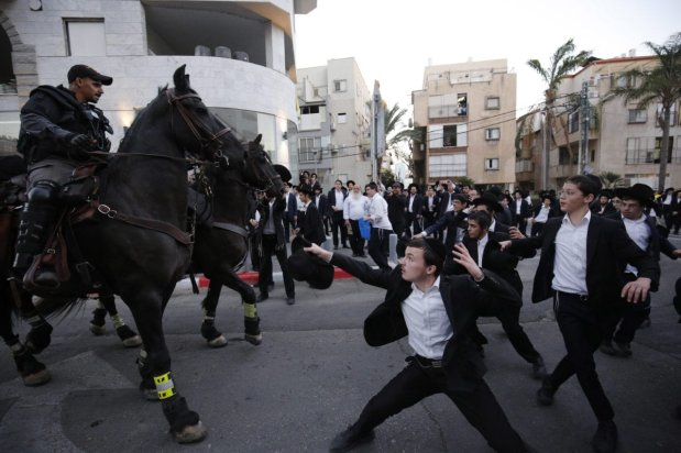 Israeli police clash with Ultra Orthodox Jewish protestors, who are staging a protest against compulsory military service in Bnei Brak town of Tel Aviv, Israel on November 1, 2018 [Mostafa Alkharouf / Anadolu Agency]