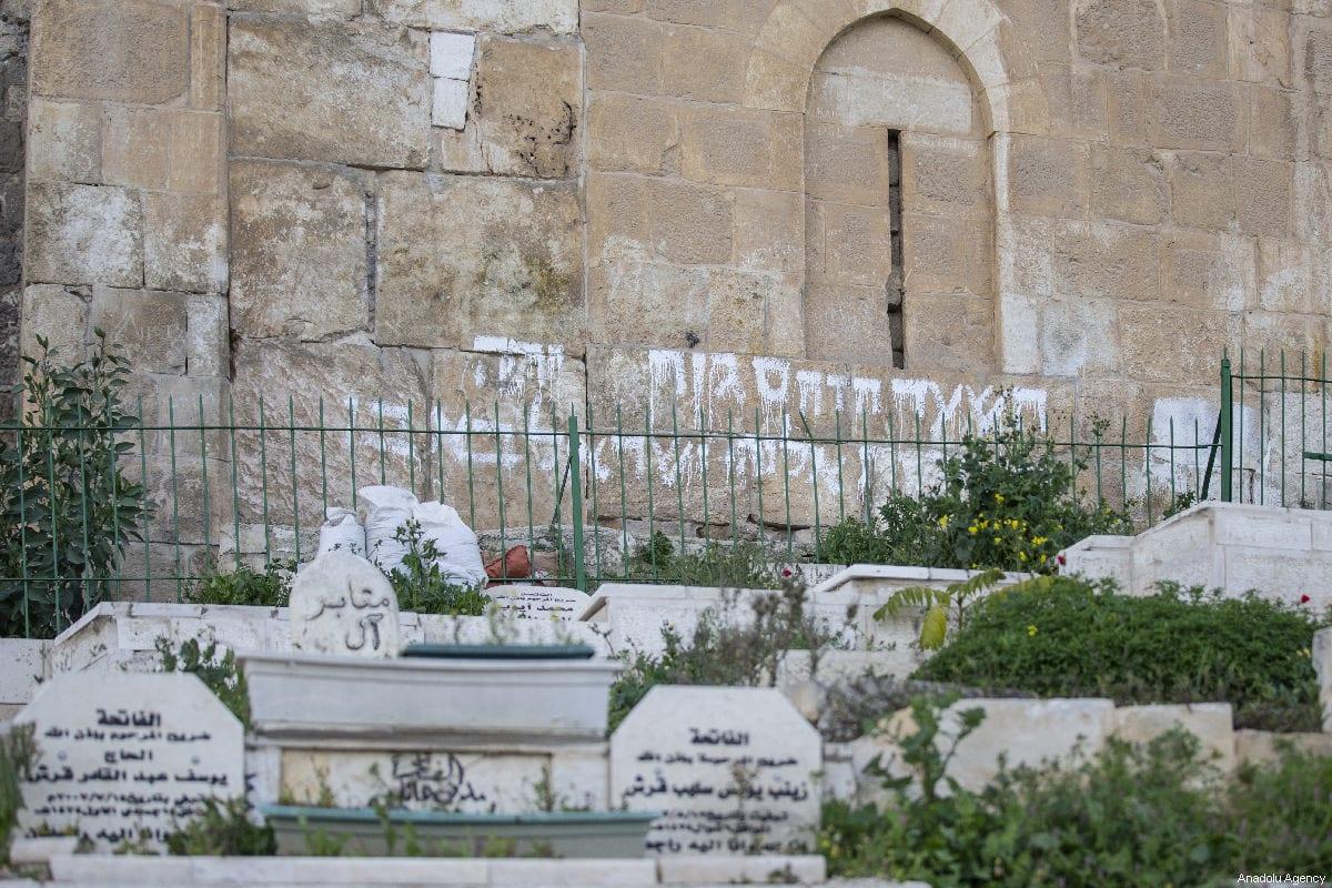 Racist graffiti sprayed next to Al-Rahma Gate by a Jewish settler in Jerusalem on 26 February 2019 [Faiz Abu Rmeleh/Anadolu Agency]