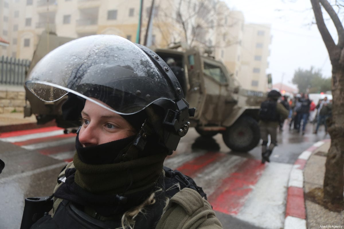 Israeli forces prepare for a raid in the West Bank on 27 January 2019 [Issam Rimawi/Anadolu Agency]