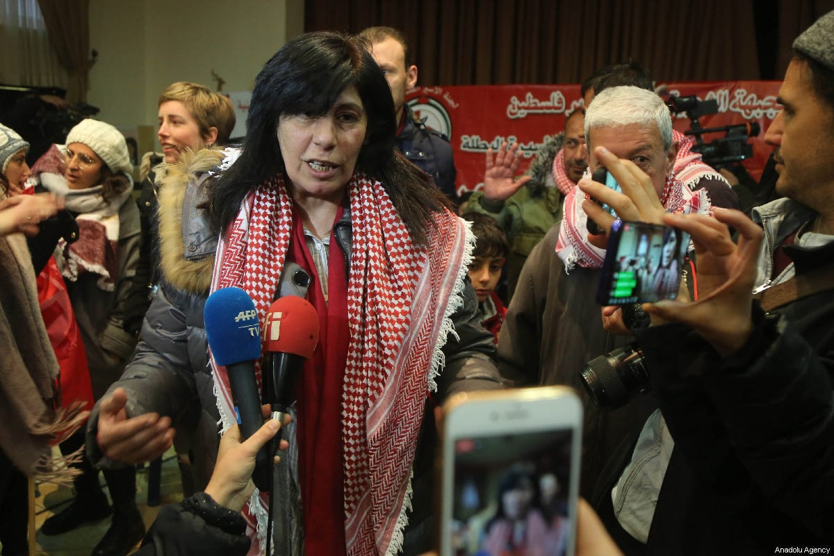Member of Palestinian Popular Front for the Liberation of Palestine (PFLP) and former lawmaker at the Palestinian Legislative Council (PLC) Khalida Jarrar (C) speaks to press as she is welcomed by her supporters and relatives after she was released from detention lasted 20 months, at her house in Nablus, West Bank on 28 February 2019. [Issam Rimawi - Anadolu Agency]