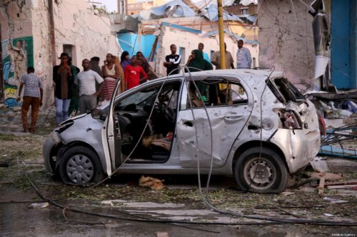 A damaged vehicle is seen as team arrives to clean scene after a terror attack carried out with a bomb-laden vehicle in the Somali capital Mogadishu which killed at least 18 people and wounded 40 others, on March 01, 2019 in Mogadishu, Somalia. [Sadak Mohamed - Anadolu Agency]