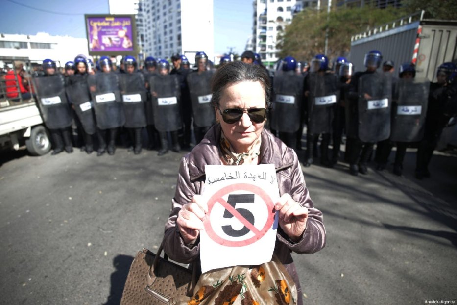 A woman holds a banner during a demonstration to protest against candidacy of President Abdelaziz Bouteflika for a fifth term in Algiers, Algeria on 1 March, 2019 [Farouk Batiche/Anadolu Agency]