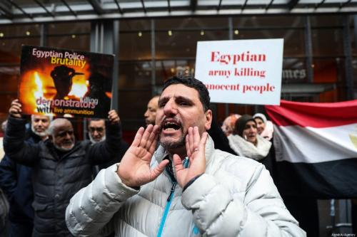 A group of people gather to stage a protest against executions in Egypt, in front of the New York Times Building, in New York, United States, on 02 March 2019. ( Atılgan Özdil - Anadolu Agency )