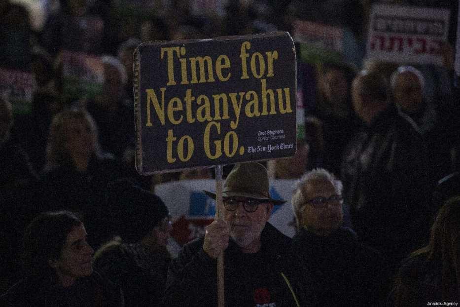 Demonstrators hold placards and shout slogans during the protest against Israeli Prime Minister Benjamin Netanyahu in Tel Aviv, Israel on March 03, 2019 [Faiz Abu Rmeleh / Anadolu Agency]