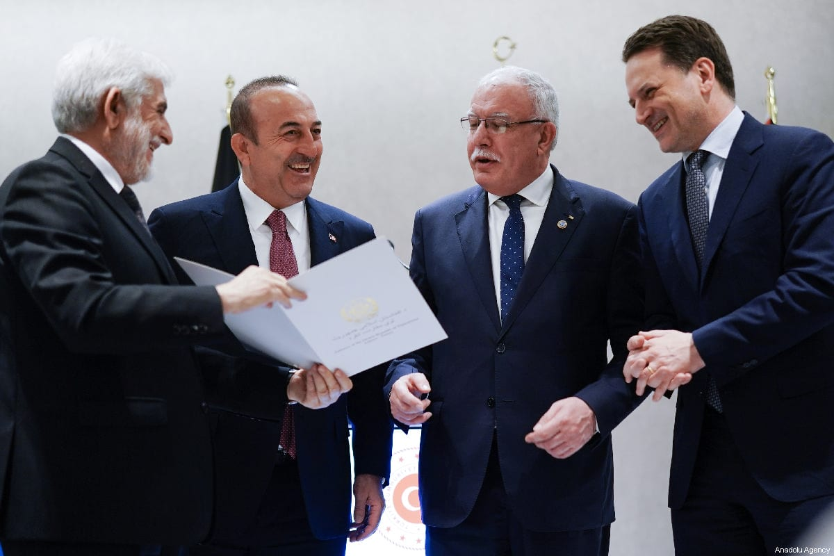 Left to Right: Afghanistan's ambassador to Turkey Abdul Rahim Sayed, Turkish Foreign Minister Mevlut Cavusoglu, Palestinian Foreign Minister Riyad al-Maliki, and UNRWA Commissioner-General Pierre Krahenbuhl attend a meeting for presenting a $1 million aid cheque by Afghanistan to UNRWA in Istanbul, Turkey on March 03, 2019 [Cem Özdel / Anadolu Agency]