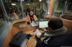 Gazans from the first convoy seen at the border control desk on the Palestinian side of the Rafah crossing, ahead of their journey to Mecca for the Umrah, after Egypt re-opened the Rafah Crossing following four years of closure, in Rafah, Gaza on March 03, 2019 [Mohammad Asad / Middle East Monitor]