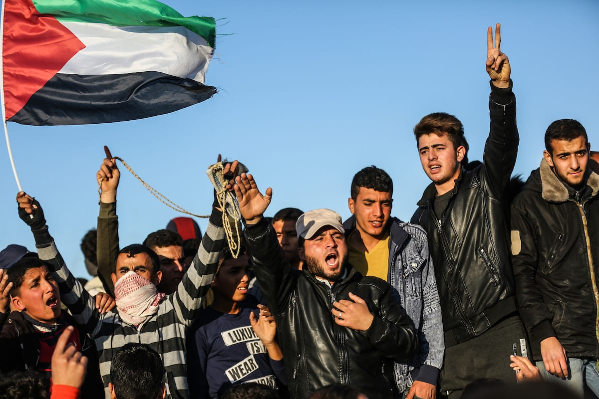 "Protesters hold flags and chant slogans during ""Great March of Return"" demonstration near Israel-Gaza border, in Khan Yunis, Gaza on 8 March 2019. [Mustafa Hassona - Anadolu Agency]"
