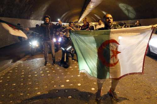 A group of people take the street to celebrate after Algeria's President Abdelaziz Bouteflika postponed the April presidential election and withdrew his candidacy in Algiers, Algeria on 11 March, 2019 [Farouk Batiche/Anadolu Agency]
