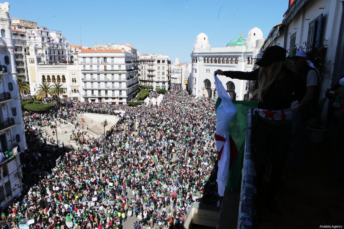 Thousands of Algerians protest against President Abdelaziz Bouteflika's decision this week to postpone presidential elections in Algiers, Algeria on 15 March 2019 [Farouk Batiche/Anadolu Agency]