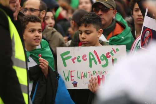 People stage a demonstration demanding regime change in Algeria at Trafalgar Square in London, United Kingdom on 16 March, 2019 [Tayfun Salcı/Anadolu Agency]