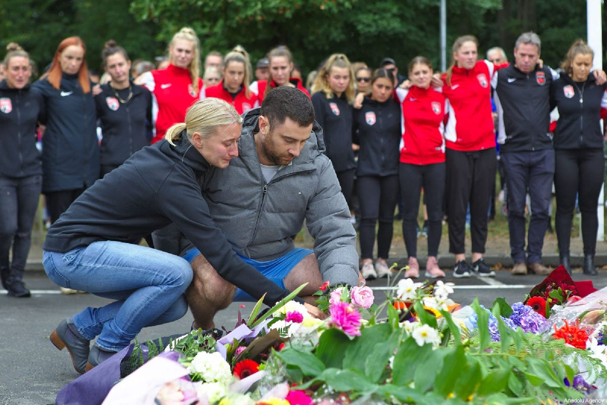 Members of the Canterbury United Pride soccer team pay tribute to their goal keeper who died at the Masjid Al Noor Mosque attack on March 15, in Christchurch, New Zealand on March 17, 2019 [Peter Adones / Anadolu Agency]