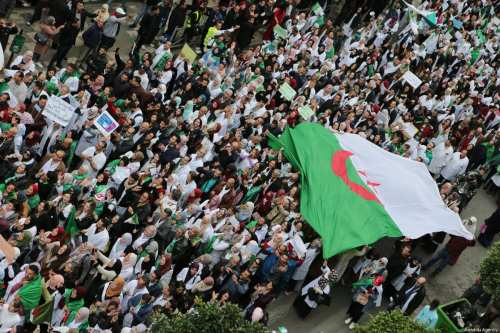 Thousands of students, doctors and civil servants stage a protest to demand President Abdelaziz Bouteflika step from power, in front of Central Post Office Square in Algiers, Algeria on March 19, 2019 [Farouk Batiche / Anadolu Agency]