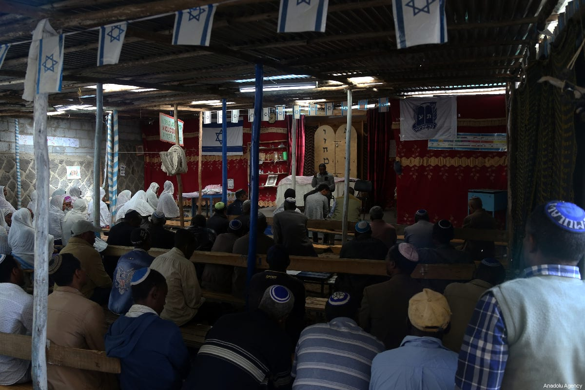 Ethiopian Jews gather for a solemn collective prayer at a small synagogue in Lamberet, a neighborhood adjacent the Israeli embassy in the Ethiopian capital of Addis Ababa on 23 February 2019. [Minasse Wondimu Hailu - Anadolu Agency]