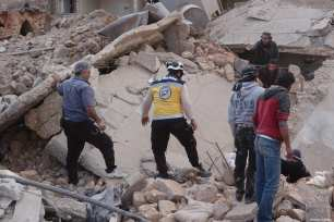 IDLIB, SYRIA - MARCH 22: Civil defense members conduct a search and rescue operation under the rubbles of demolished buildings after airstrikes hit the residential areas of de-escalation zone Idlib, Syria on March 22, 2019. ( Hasan Muhtar - Anadolu Agency )