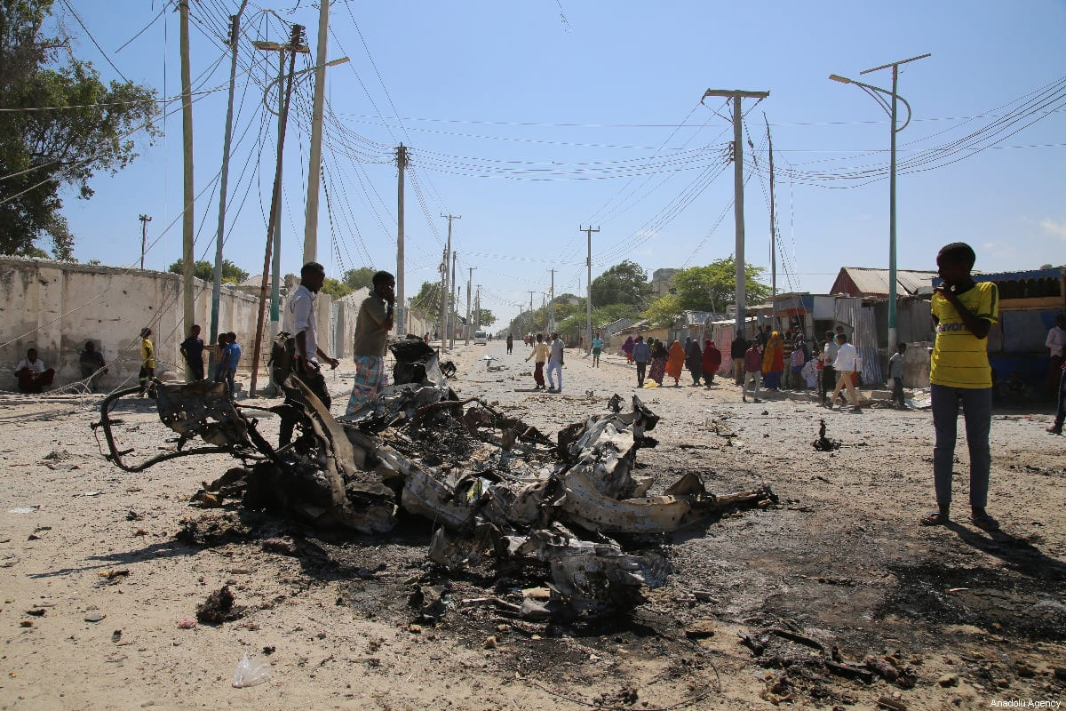 Explosion site is seen after a terror attack carried out by Al-Qaeda-affiliated terrorist group al-Shabaab with a bomb-laden vehicle near two ministry buildings in the Somalian capital of Mogadishu on March 23, 2019 [Sadak Mohamed / Anadolu Agency]