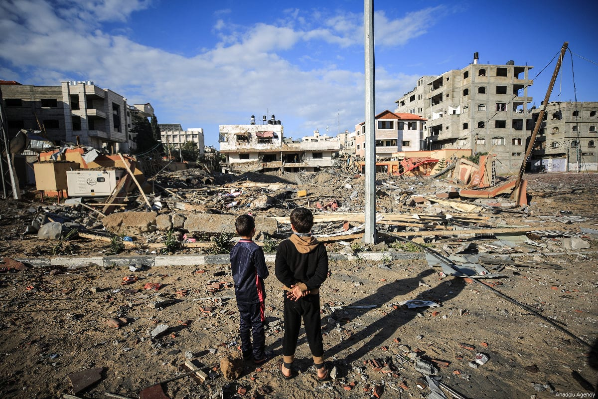 Palestinian young boys look at the wreckage of Head of the Political Bureau of Hamas, Ismail Haniyeh's office and close site after Israeli warplanes carry out airstrikes across the blockaded Gaza Strip despite the ceasefire, in Gaza City, Gaza on March 26, 2019 [Ali Jadallah / Anadolu Agency]
