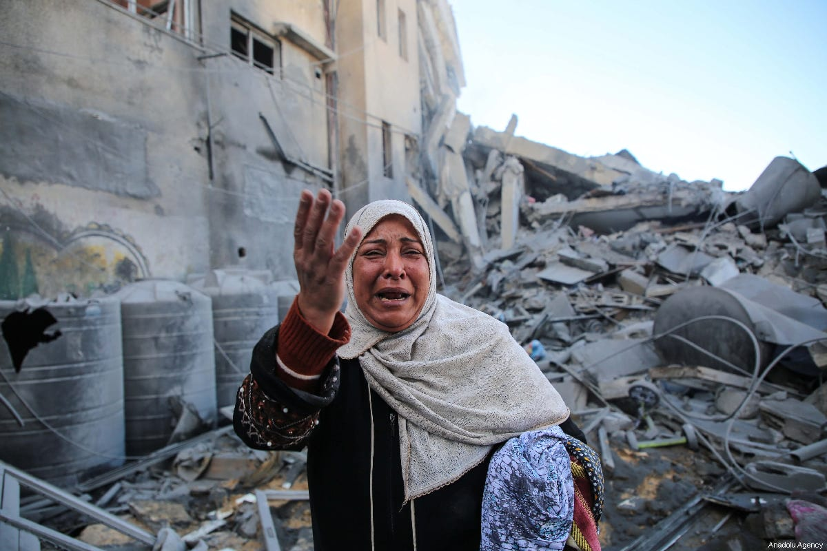 A resident, Maryam El Shawa reacts at wreckage of Hassona building after Israeli warplanes carried out airstrike towards the building in Rimal neighbourhood of Gaza City, Gaza on 26 March 2019. [Hassan Jedi - Anadolu Agency]