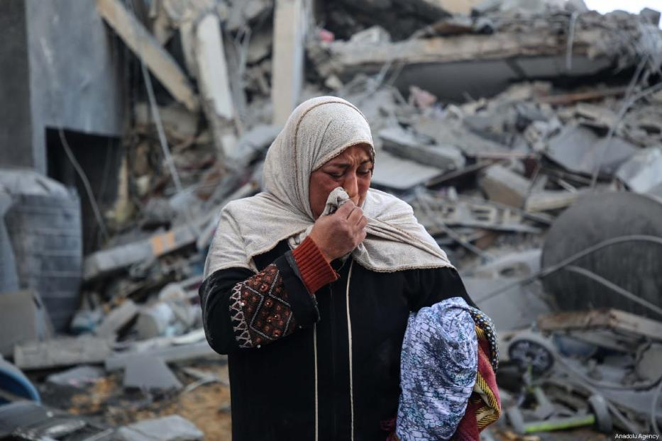 A Palestinian woman in tears after her home was destroyed after Israel carried our air strikes in Gaza on 26 March 2019 [Hassan Jedi/Anadolu Agency]