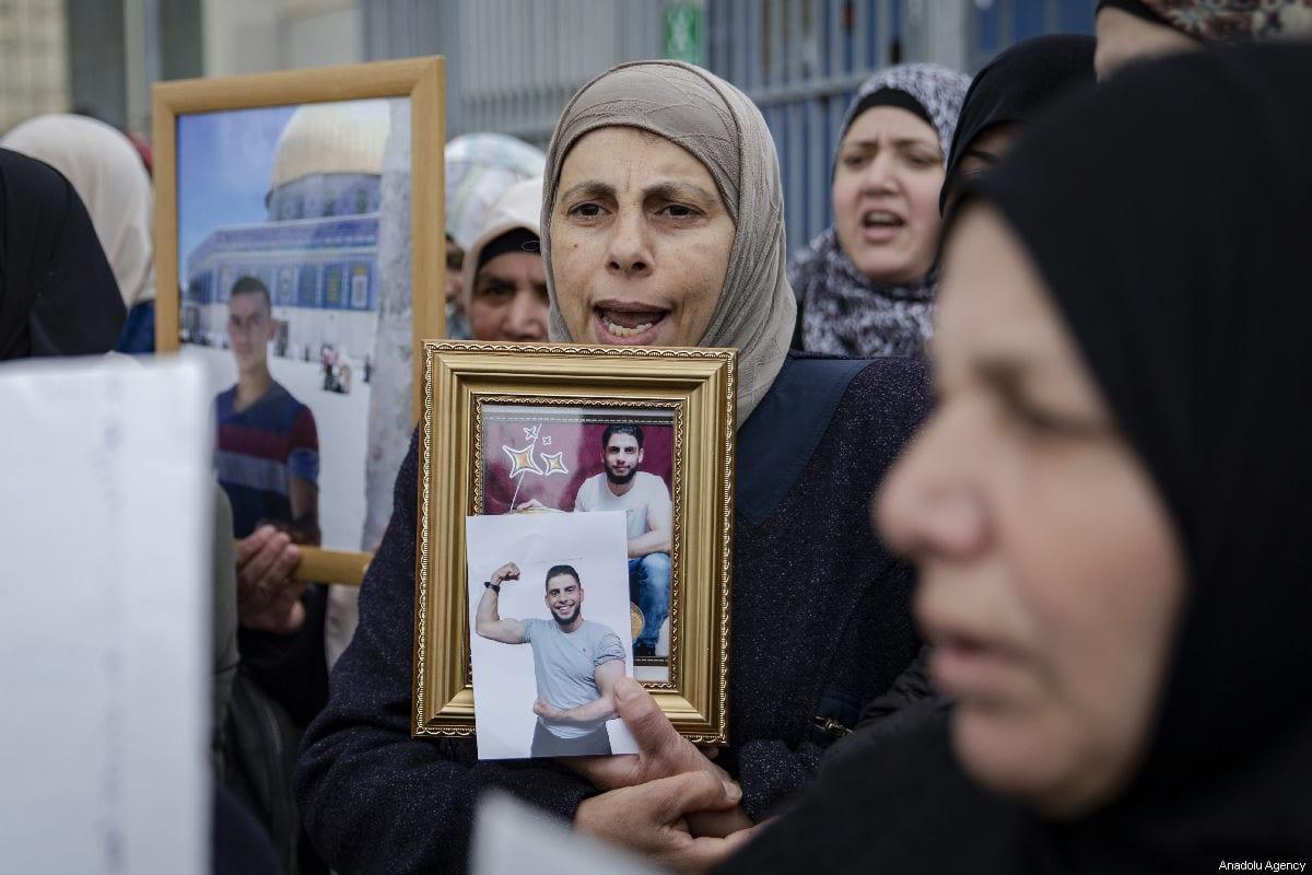 Palestinians demanding the release of Palestinian prisoners held in Israeli jails, stage a demonstration in Sheikh Jarrah neighborhood of Eastern Jerusalem on 26 March, 2019 [Faiz Abu Rmeleh/Anadolu Agency]