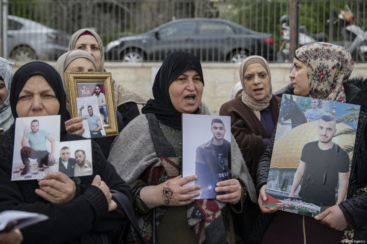 Palestinians demanding the release of Palestinian prisoners held in Israeli jails, stage a demonstration in Sheikh Jarrah neighborhood of Eastern Jerusalem on March 26, 2019. [Faiz Abu Rmeleh/Anadolu Agency]