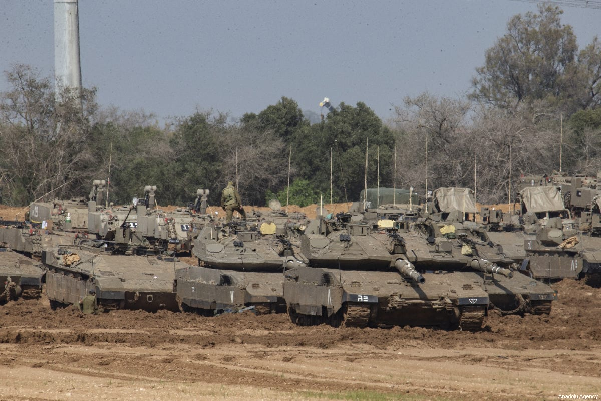 "Israeli tanks and armoured vehicles are deployed to the Gaza Strip border ahead of the anniversary march of the ""Great March of Return"", in Sderot, Israel on March 29, 2019 [Faiz Abu Rmeleh / Anadolu Agency]"
