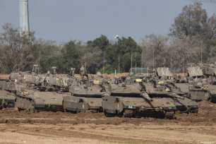 """Israeli tanks and armoured vehicles are deployed to the Gaza Strip border ahead of the anniversary march of the """"Great March of Return"""", in Sderot, Israel on March 29, 2019 [Faiz Abu Rmeleh / Anadolu Agency]"""
