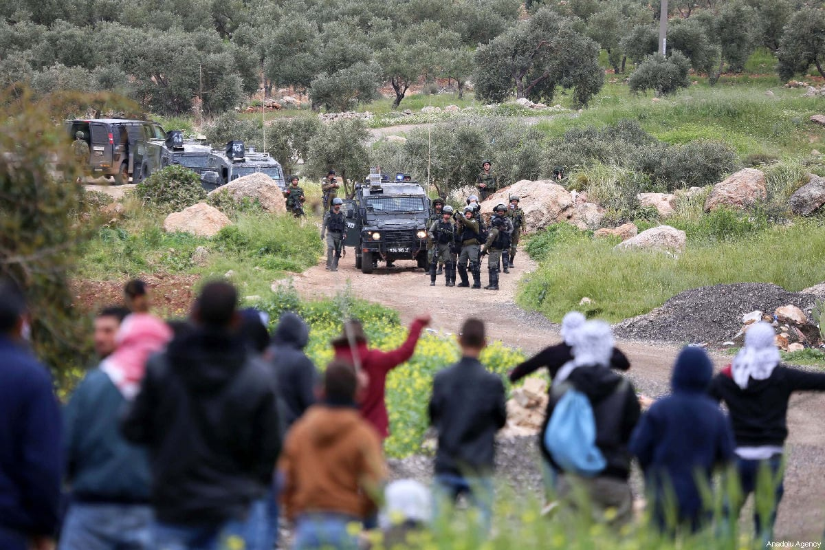 Israeli forces intervene in Palestinians during a protest against construction of Jewish settlement within 43rd anniversary of Palestinian Land Day in Ramallah, West Bank on March 29, 2019. [Issam Rimawi - Anadolu Agency]