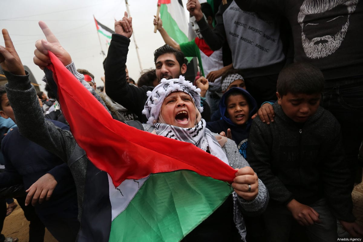 """Protesters gather to attend """"Great March of Return"""" and """"Palestinian Land Day"""" demonstrations at Israel-Gaza border located in eastern Khan Yunis, Gaza on March 30, 2019 [Ashraf Amra / Anadolu Agency]"""
