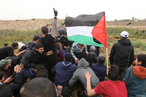 "Palestinians seen at the anniversary march of the ""Great March of Return"" and ""Palestinian Land Day"" protests at Israel-Gaza border located near Al Bureij Refugee Camp in Gaza City, Gaza on March 30, 2019 [Hassan Jedi / Anadolu Agency]"