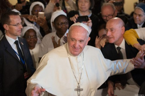 Pope Francis greets people during his visit at the St. Peter's Cathedral in Rabat, Morocco on March 31, 2019 [Jalal Morchidi / Anadolu Agency]