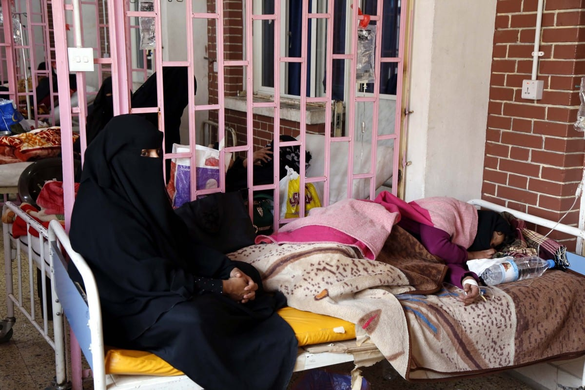 A Yemeni women receive treatment for cholera in Sanaa, Yemen on 10 March 2019 [Mohammed Hamoud/Anadolu Agency]