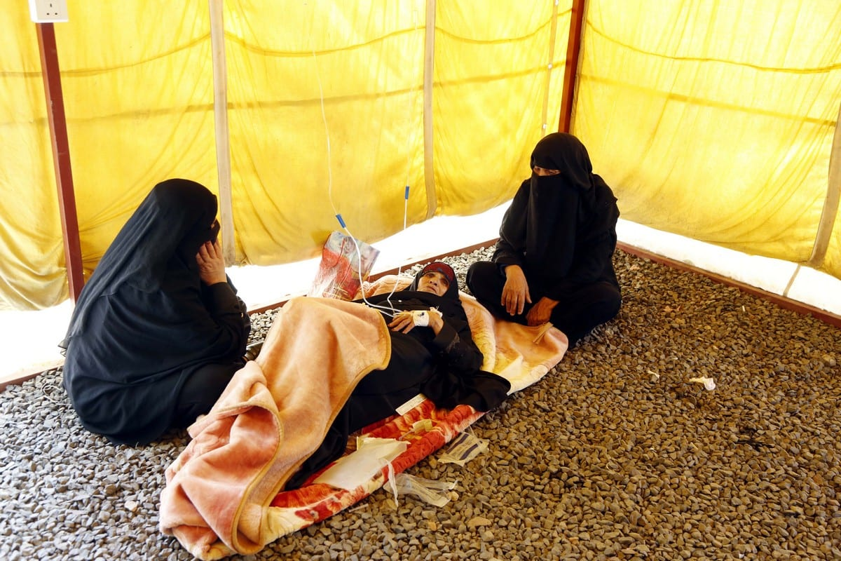 Due to the lack of hospital beds, Yemeni women receive treatment at a tent adjacent to the Hospital's garden in Sanaa, Yemen on 10 March 2019 [Mohammed Hamoud/Anadolu Agency]