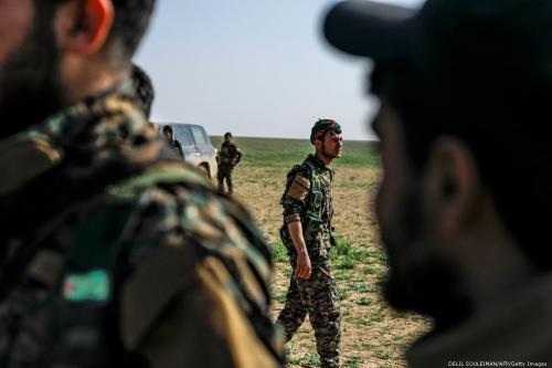 Fighters with the US-backed Syrian Democratic Forces (SDF) gather in Deir Ezzor, Syria on 25 February 2019 [DELIL SOULEIMAN/AFP/Getty Images]