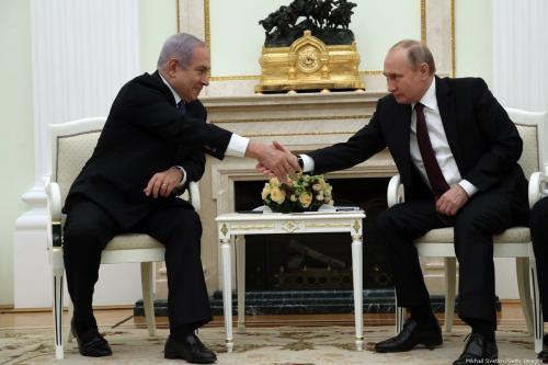 Russian President Vladimir Putin (R) greets Israeli Prime Minister Benjamin Netanyahu (L) during their talks at the Kremlin on 27 February 2019 in Moscow, Russia [Mikhail Svetlov/Getty Images]