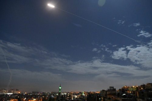A picture taken early on January 21, 2019 shows Syrian air defence batteries responding to what the Syrian state media said were Israeli missiles targeting Damascus [STR/AFP/Getty Images]