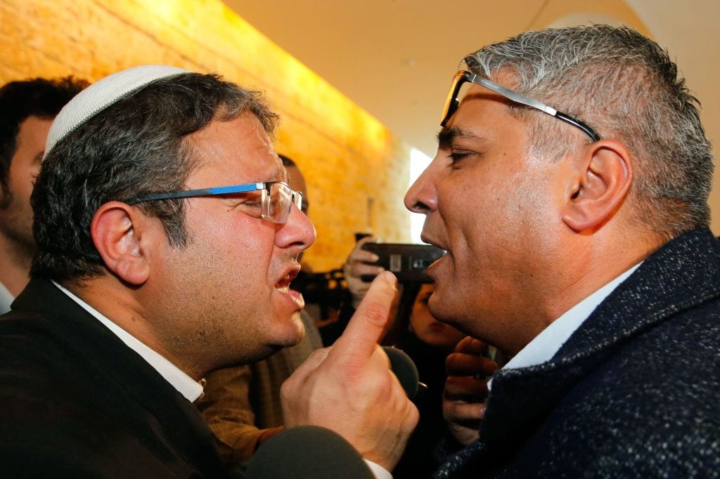 Jewish Power party's Itamar Ben Gvir (L) argues with the Israeli Arab candidate Ata Abu Medeghem of Raam-Balad after a hearing at the Israeli Supreme Court in Jerusalem, on March 14, 2019. [GIL COHEN-MAGEN/AFP/Getty Image]