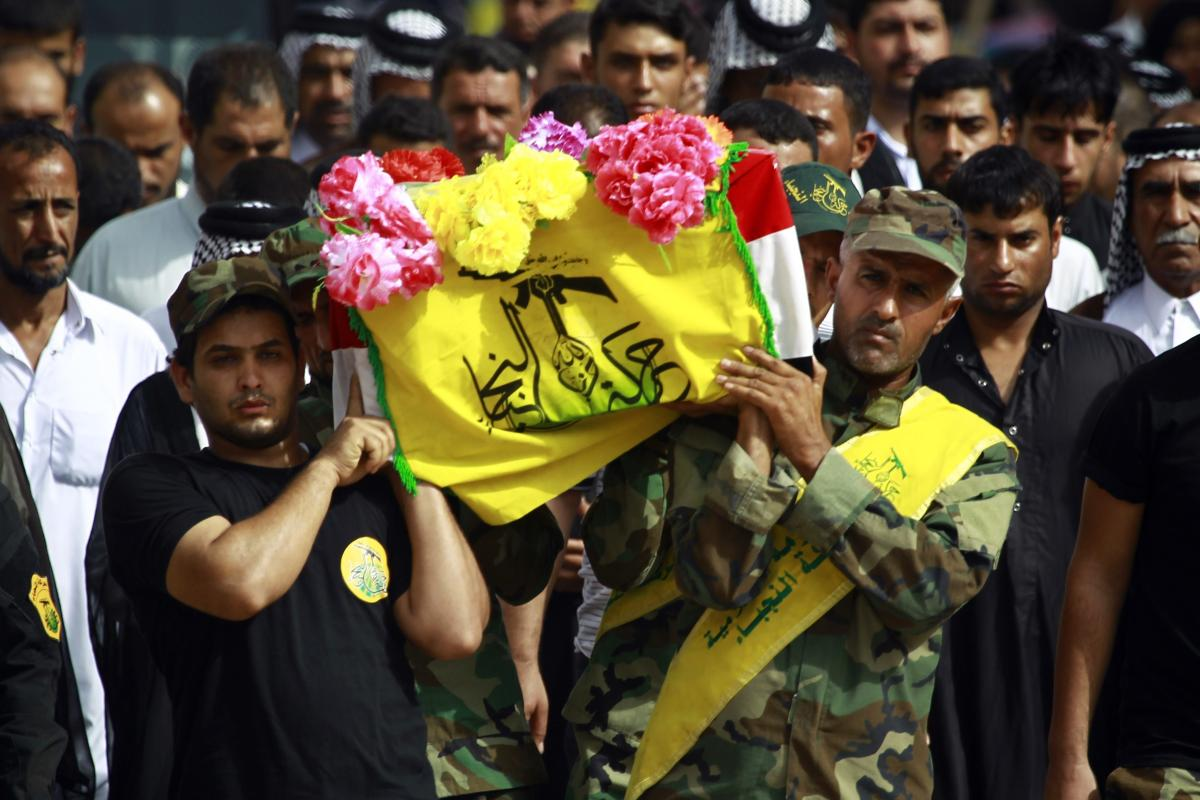 Members Iraq's Shiite Muslim al-Nujaba movement, carry coffins of comrades at a funeral in the holy city of Najaf on 17 September 2015 after they were killed in clashes against the Daesh group in Syria. AFP PHOTO / HAIDAR HAMDANI/Getty